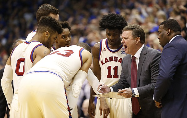 Kansas head coach Bill Self pulls in the Jayhawks for a huddle with seconds remaining in overtime, Monday, Feb. 13, 2017 at Allen Fieldhouse.