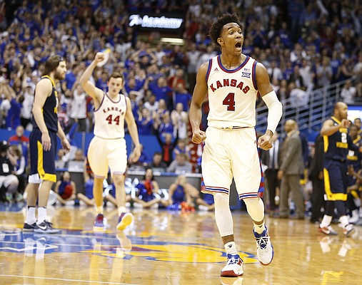 Kansas guard Devonte' Graham (4) gets fired up as the Jayhawks close in on the West Virginia lead during the second half, Monday, Feb. 13, 2017 at Allen Fieldhouse.