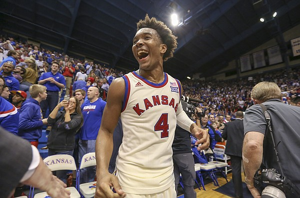 Kansas guard Devonte' Graham (4) celebrates the Jayhawks' 84-80 win over West Virginia, Monday, Feb. 13, 2017 at Allen Fieldhouse.