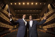Identical twin brothers Stephen Tucker, left, and Paul Tucker, both conductors, will both conduct at Saturday's University of Kansas School of Music Scholarship Concert at the Lied Center. Paul Tucker is director of choral activities and associate professor of music in the School of Music at KU. Stephen Tucker is director of orchestras and associate professor of music at the Claire Trevor School of the Arts at University of California, Irvine.