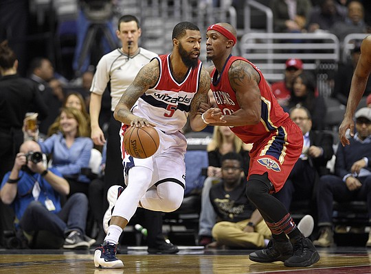 Washington Wizards forward Markieff Morris (5) dribbles against New Orleans Pelicans forward Dante Cunningham (33) during the first half of an NBA basketball game, Saturday, Feb. 4, 2017, in Washington. (AP Photo/Nick Wass)