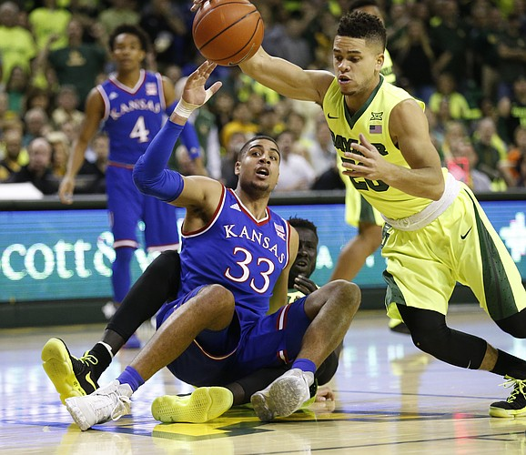 Baylor guard Manu Lecomte (20) comes away with a ball from Kansas forward Landen Lucas (33) who is called for a foul during the first half, Saturday, Feb. 18, 2017 at Ferrell Center in Waco, Texas.