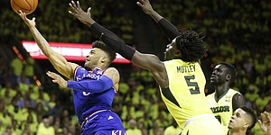 Kansas guard Frank Mason III (0) tries to get a bucket in past Baylor forward Johnathan Motley (5) during the first half, Saturday, Feb. 18, 2017 at Ferrell Center in Waco, Texas.
