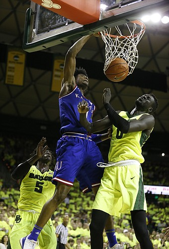 Kansas guard Josh Jackson (11) drills home a dunk over Baylor forward Jo Lual-Acuil Jr. (0) during the second half, Saturday, Feb. 18, 2017 at Ferrell Center in Waco, Texas.