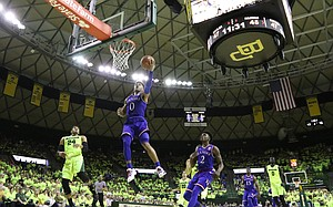 Kansas guard Frank Mason III (0) swoops in for a bucket late during the second half, Saturday, Feb. 18, 2017 at Ferrell Center in Waco, Texas.