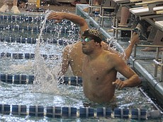 Free State senior Jordan Portela smacks the water after anchoring the Firebirds' 400-yard freestyle relay to a second-place finish to round out the Class 6A swim and dive meet on Saturday at Topeka Capitol Federal Natatorium.