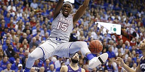 Kansas forward Carlton Bragg Jr. (15) delivers on a put back dunk during the first half, Wednesday, Feb. 22, 2017 at Allen Fieldhouse.
