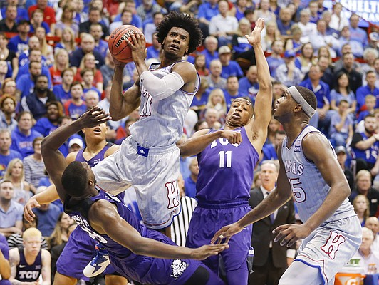 Kansas guard Josh Jackson (11) goes up to the bucket after a blocking foul by TCU forward Chris Washburn (33) during the first half, Wednesday, Feb. 22, 2017 at Allen Fieldhouse.