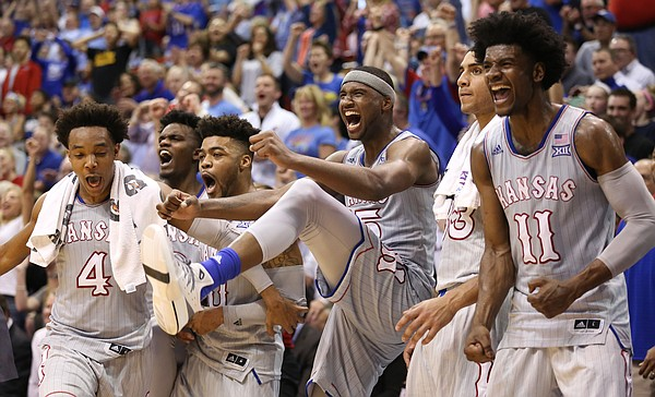 The Kansas bench erupts after a dunk by Dwight Coleby during the second half, Wednesday, Feb. 22, 2017 at Allen Fieldhouse.