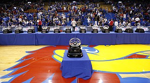 The Jayhawks' 13-straight Big 12 conference trophies are lined up along the court, Wednesday, Feb. 22, 2017 at Allen Fieldhouse.