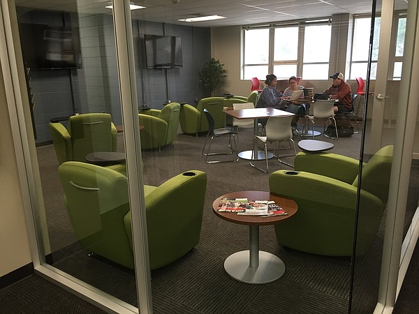 Students gather in the lounge area of the new University of Kansas Student Veteran Center, which opened in early 2017 in 345 Summerfield Hall.