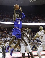 Kansas guard Josh Jackson (11) shoots over Texas defenders Andrew Jones (1) and Jarrett Allen (31) during the first half of an NCAA college basketball game, Saturday, Feb. 25, 2017, in Austin, Texas.