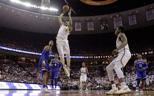 Texas forward Jarrett Allen (31) scores against Kansas during the second half of an NCAA college basketball game, Saturday, Feb. 25, 2017, in Austin, Texas.