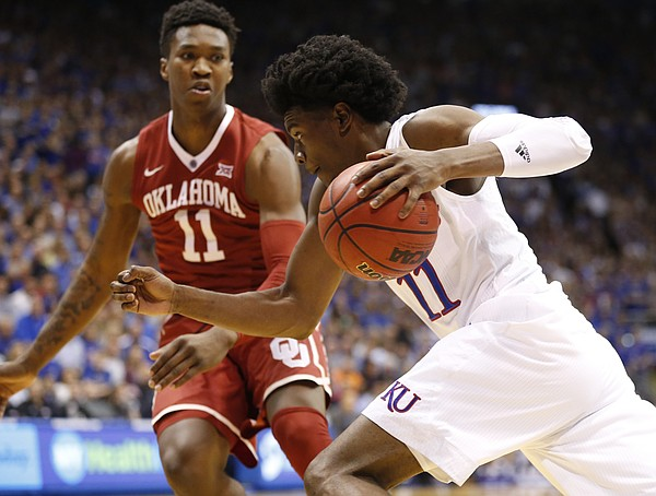 Kansas guard Josh Jackson (11) drives against Oklahoma forward Kristian Doolittle (11) during the first half, Monday, Feb. 27, 2017 at Allen Fieldhouse