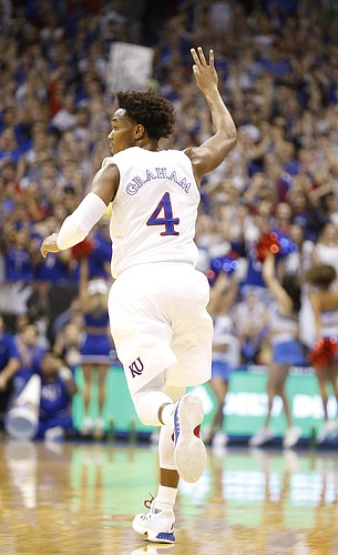 Kansas guard Devonte' Graham (4) raises his hand after hitting a three during the first half, Monday, Feb. 27, 2017 at Allen Fieldhouse