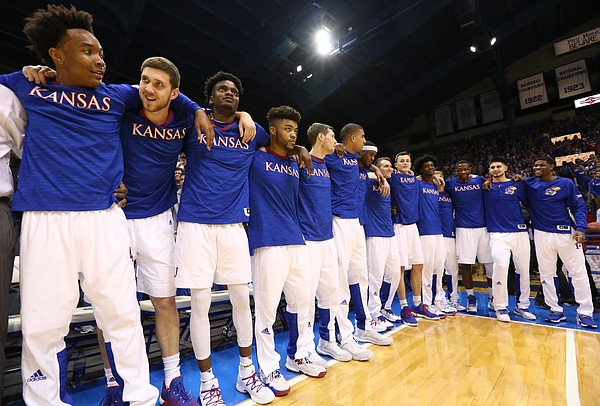 The Kansas Jayhawks sing the Alma Mater prior to tipoff against Oklahoma.