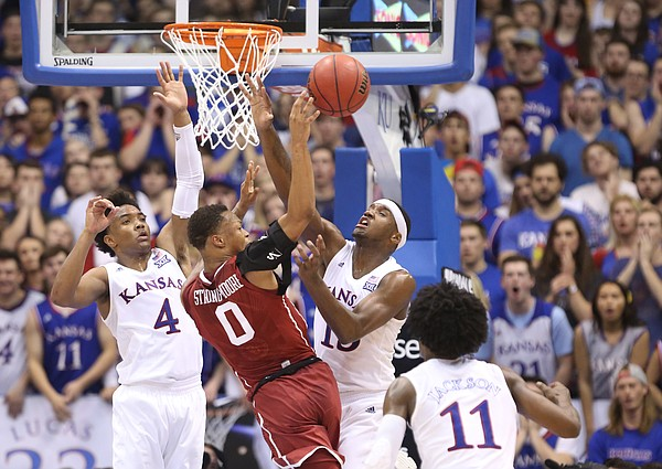 Kansas guard Devonte' Graham (4) and Kansas forward Carlton Bragg Jr. (15) pressure Oklahoma guard Darrion Strong-Moore (0) during the first half, Monday, Feb. 27, 2017 at Allen Fieldhouse.