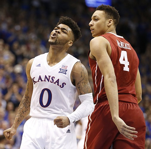 Kansas guard Frank Mason III (0) celebrates a late bucket before Oklahoma center Jamuni McNeace (4) during the second half, Monday, Feb. 27, 2017 at Allen Fieldhouse.
