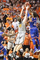 Kansas guard Devonte' Graham (4) gets up to snag a pass to Oklahoma State forward Mitchell Solomon (41) during the first half, Saturday, March 4, 2017 at Gallagher-Iba Arena.