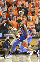 Kansas guard Lagerald Vick (2) steals a ball from Oklahoma State guard Brandon Averette (0) during the first half, Saturday, March 4, 2017 at Gallagher-Iba Arena.