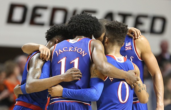 The Jayhawks come together in a huddle with little time remaining during the second half, Saturday, March 4, 2017 at Gallagher-Iba Arena.