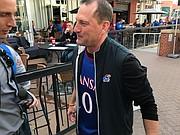 Kansas football coach David Beaty wore a Frank Mason III jersey in Kansas City, Mo., on March 9, 2017, prior to the KU basketball team's Big 12 quarterfinal versus TCU.