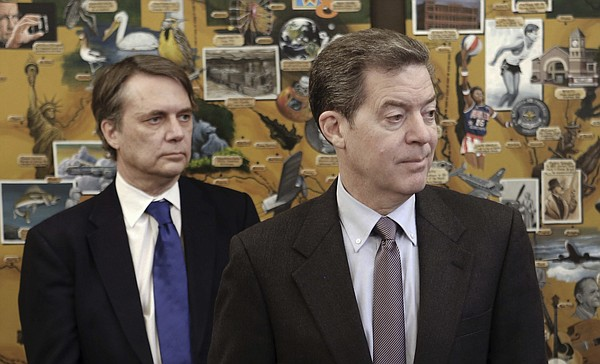Kansas Gov. Sam Brownback, right, along with Lt. Gov. Jeff Colyer participates in a Humanitarian award ceremony Thursday, March 9, 2017, at the statehouse in Topeka, Kans. The governor said he has no comment at this time about the possibility of being named to an ambassadorship in Rome representing the U.S. at United Nations agricultural organizations. (Thad Allton/Topeka Capital-Journal via AP)