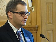 Travis Couture-Lovelady, a former legislator who now lobbies for the National Rifle Association, argues before a House committee, alleging the University of Kansas and other Regents institutions are enacting unreasonable regulations to circumvent a new law that requires them to allow people to carry concealed weapons on campus.