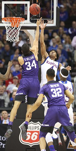 TCU guard Kenrich Williams (34) puts a shot up over Kansas guard Devonte' Graham (4) during the first half, Thursday, March 9, 2017 at Sprint Center.