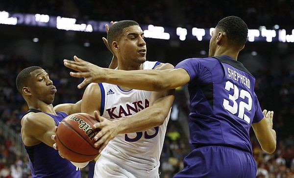 Kansas forward Landen Lucas (33) is hounded by TCU guard Brandon Parrish, left, and TCU forward Karviar Shepherd (32) during the second half, Thursday, March 9, 2017 at Sprint Center.