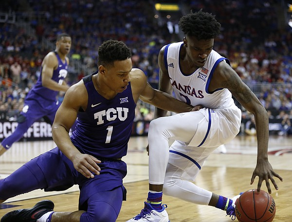 TCU guard Desmond Bane (1) fights for a loose ball with Kansas guard Lagerald Vick (2) during the second half, Thursday, March 9, 2017 at Sprint Center.