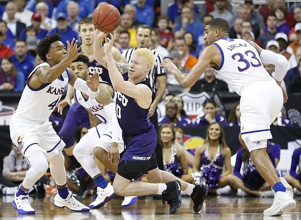 Kansas guard Devonte' Graham (4) pressures TCU guard Jaylen Fisher (0) during the second half, Thursday, March 9, 2017 at Sprint Center. At right is Kansas forward Landen Lucas (33).