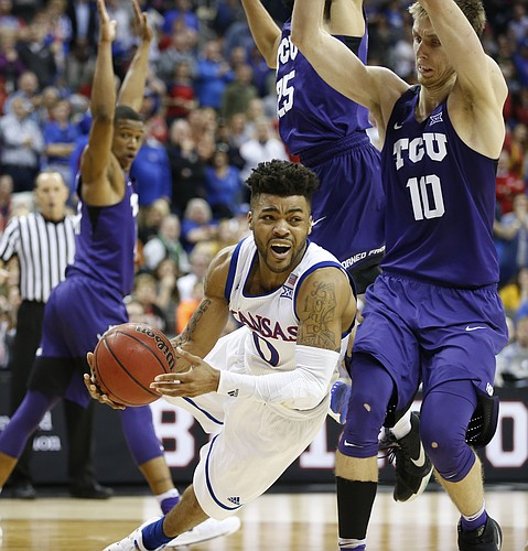 Kansas guard Frank Mason III (0) is fouled with seconds to go during the second half, Thursday, March 9, 2017 at Sprint Center. At right is TCU forward Vladimir Brodziansky (10).