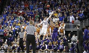 Kansas guard Sviatoslav Mykhailiuk (10) comes down on top of TCU guard Desmond Bane (1) after blocking a three-point shot with seconds to go in the game, Thursday, March 9, 2017 at Sprint Center. Mykhailiuk fouled Bane, who made all three free throws, which were enough to give the Horned Frogs the win.