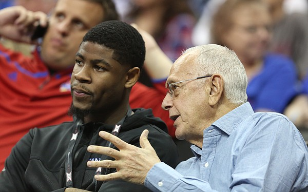 Former Kansas head coach Larry Brown talks with red shirt Malik Newman during the second half, Thursday, March 9, 2017 at Sprint Center.