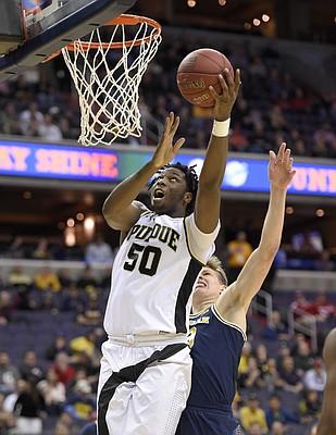 Purdue sophomore Caleb Swanigan puts up shot against Michigan. (AP photo).