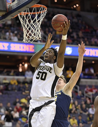 Purdue sophomore Caleb Swanigan puts up shot against Michigan. (AP photo).