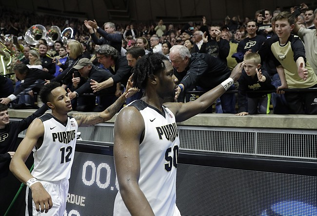 Caleb Swanigan (right) and Vince Edwards give Purdue size, scoring versatility. (AP photo).
