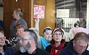 An audience member voices her wishes for the repeal of the Affordable Care Act during a listening tour for Rep. Lynn Jenkins on Monday, March 13, 2017 at the Dole Institute of Politics.