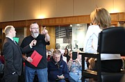 Chris Johnston, of Ottawa, questions U.S. Rep. Lynn Jenkins, R-Kan., on figures released by the Congressional Budget Office with regard for Republicans' health care plan during a listening tour on Monday, March 13, 2017 at the Dole Institute of Politics.