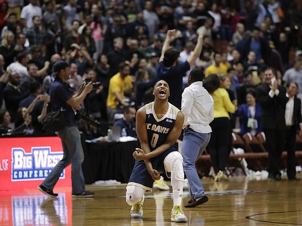 UC Davis' Brynton Lemar celebrates his team's 50-47 win against UC Irvine in an NCAA college basketball game for the championship of the Big West tournament Saturday, March 11, 2017, in Anaheim, Calif. (AP Photo/Jae C. Hong)