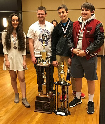 Lawrence High School recently won the K-12 overall championship, and finished first among 6A schools, at the Kansas Scholastic Chess Association state competition Saturday, March 11, at Emporia State University. Pictured here from left to right are LHS competitors Kiana Hajiarbabi, Jose Smokowski, Isaac Lee and John Ely.