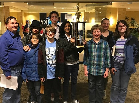 West Middle School placed second in the K-8 category of the Kansas Scholastic Chess Association's state tournament March 11 at Emporia State University. Pictured here from left to right are: (back row) Noah Rantilla, Samuel Coleman and Logan Camarda, (front row) coach Kyle Camarda, Max Rantilla, Quincy Kastens, Rita Joseph (holding trophy), Ike Pawlush and Susan Mechem.