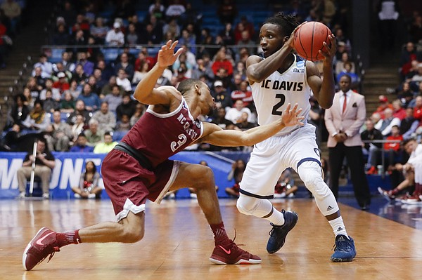 UC Davis' Darius Graham (2) looks to pass against North Carolina Central's Rashaun Madison (3) during the second half of a First Four game of the NCAA men's college basketball tournament, Wednesday, March 15, 2017, in Dayton, Ohio. UC Davis won 67-63.