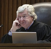 Kansas Supreme Court Justice Dan Biles listened and asked questions Thursday, March 16, 2017, during oral arguments in a legal fight over a state law banning a second-trimester abortion procedure and the larger question of whether the state constitution's Bill of Rights offered a fundamental right to an abortion. (Thad Allton/The Topeka Capital-Journal via AP, Pool)