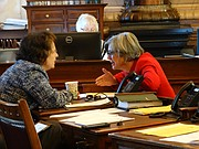 Senate budget committee chairwoman Carolyn McGinn, left, and Senate President Susan Wagle confer with each other shortly before debate on a bill aimed at filling a $281 million shortfall in the current fiscal year's budget.