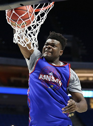 Injured Kansas center Udoka Azubuike (35) delivers a dunk at the end of the Jayhawks' practice on Thursday, March 16, 2017 at BOK Center in Tulsa, Oklahoma.