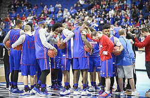 The Jayhawks come together in a huddle at the start of practice on Thursday, March 16, 2017 at BOK Center in Tulsa, Oklahoma.