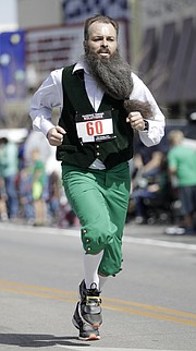 Mike Ostrekko, Lawrence, competes in the Ad Astra Irish Mile race through downtown on Friday afternoon, March 17, 2017.