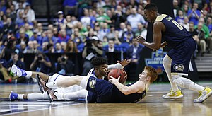 Kansas guard Frank Mason III (0) tries to recover a loose ball from UC Davis guard Siler Schneider during the first half on Friday, March 17, 2017 at BOK Center in Tulsa, Oklahoma. At right is UC Davis guard Brynton Lemar (0).